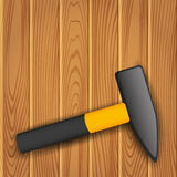 Hammer on wood background. Royalty Free Stock Photos
