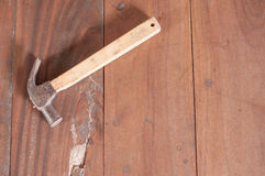Hammer on wood board Royalty Free Stock Photo