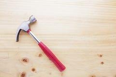 A hammer on a wood table Stock Photos