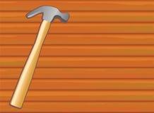 Hammer on wood texture Stock Photos