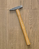 Hammer on wooden background Royalty Free Stock Image