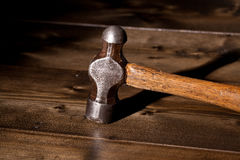 Hammer on a wooden floor Royalty Free Stock Photos
