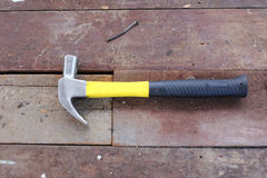A hammer on wooden floor Royalty Free Stock Photos