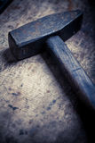 Hammer on wooden plank Stock Photo