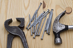 Hammer ,wrench and nails on wood background Stock Photography