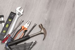 Hammer and wrenches on desk Stock Photo