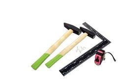 Hammer zwei, quadratisches Werkzeug und Roulette Lizenzfreies Stockfoto