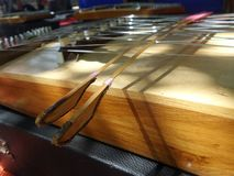 Hammered dulcimer played with two bamboo beaters Stock Photos