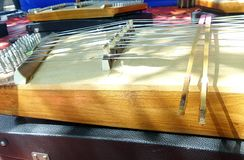 Hammered dulcimer played with two bamboo beaters Royalty Free Stock Photo