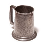 Hammered Pewter Beer Tankard. One hammered pewter beer or ale tankard Stock Images