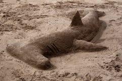 Hammerhead Shark Made Of Sand. Great hammerhead shark made of sand on the beach on Lanzarote, Canary Islands, Spain Stock Photos