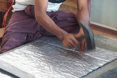 Hammering lead sheets Stock Image