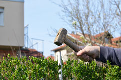Hammering a Metal Rod Stock Image