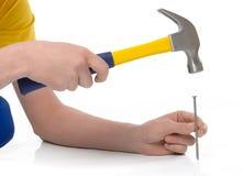 Hammering a nail Royalty Free Stock Images