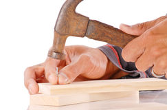 Hammering a Nail Stock Photography