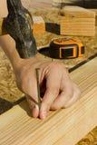 Hammering a Nail Stock Image