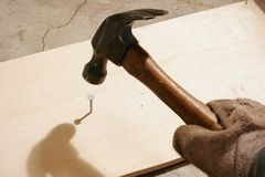 Hammering a Nail Royalty Free Stock Photo