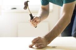 Hammering a nail Royalty Free Stock Image