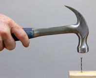 Hammering in a Nail Royalty Free Stock Image