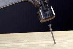 Hammer and nail closeup Royalty Free Stock Photo