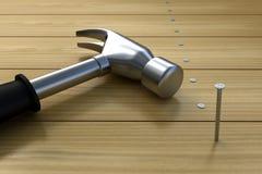 Hammering nails into wood Stock Photos