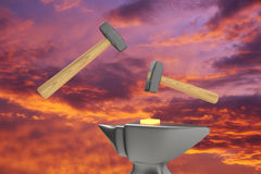 Hammers forge metal. The symbolic image of two hammers and anvils to work on forging hot metal on a sky background. 3D rendering Royalty Free Stock Photos