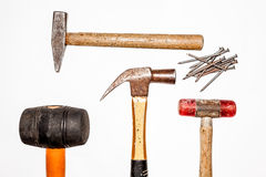 Hammers and nails Stock Images