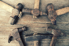 Hammers on an old dirty grunge wooden background Royalty Free Stock Image