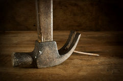 Hammers old wooden table on brown. Stock Image
