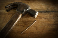 Hammers old wooden table on brown low key light. Royalty Free Stock Image