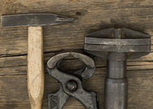 Hammers and pliers Stock Images