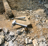Hammers Remain in the Dirt After a Long Day of Work Royalty Free Stock Photography