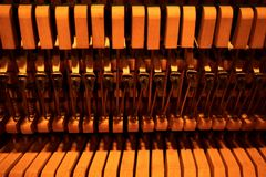 Hammers and strings inside piano stock photography