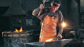 Hammersmith is striking incandescent metal in slow motion. HD stock video footage