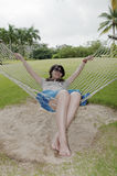 Hammock. In hammock's woman,Comfortable holiday Stock Photos