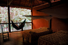 Hammock. A typical hammock in a jungle lodge royalty free stock images
