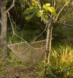 Hammock. A net hammock in the backyard Royalty Free Stock Photo