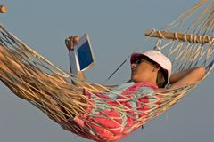 Hammock on the beach. Woman in a hammock on a beach Royalty Free Stock Images