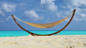 Hammock on Beach. An Empty Hammock on Beach under Sunlight stock video