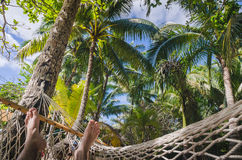 In the hammock at the beach, point of view Stock Images