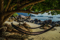Hammock on the beach. Ralaxing in the hammock on the sandy beach stock image