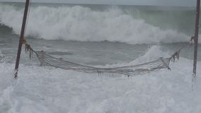 Hammock on the beach during a storm,big waves.  stock video