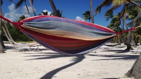Hammock on the beach. At sunny day stock video footage