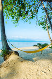 Hammock on the beach Stock Photo