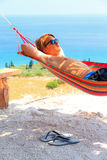 Hammock boy flipflops Royalty Free Stock Image