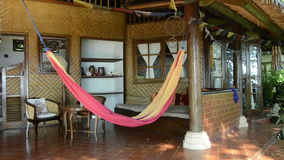 Hammock in a bungalow in Bali, indonesia. Swinging in wind stock video footage