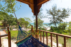 Hammock and bungalows on tropical beach Koh Rong Island, Cambodi Stock Image