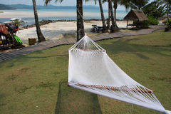 Hammock between coconut trees on tropical beach. Empty hammock between coconut trees on tropical beach Royalty Free Stock Images