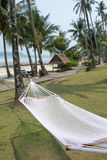 Hammock between coconut trees on tropical beach. Empty hammock between coconut trees on tropical beach Stock Photography