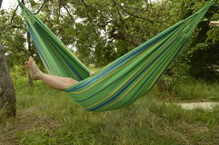 Hammock. Enjoy summer holidays on hammock, holiday greetings stock photo